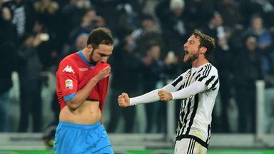 Juventus' Claudio Marchisio celebrates in front of Napoli's Gonzalo Higuain