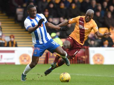 Tope Obadeyi and Morgaro Gomis battle for the ball