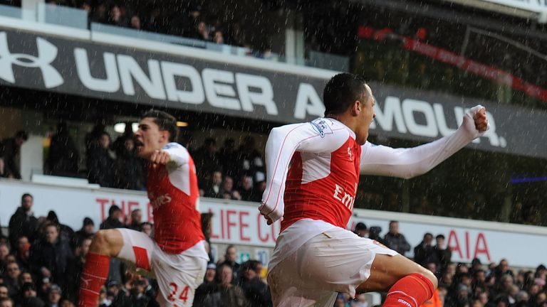 Alexis Sanchez rescued a point for 10-man Arsenal in Saturday's north London derby.