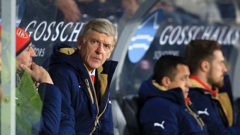 Arsene Wenger looks on during the 4-0 win at the KC Stadium