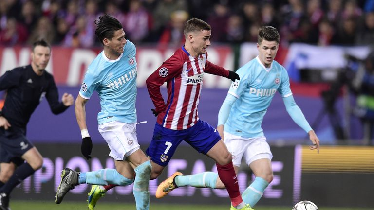 Antoine Griezmann (centre) tries to get away from Hector Moreno and Marco van Ginkel