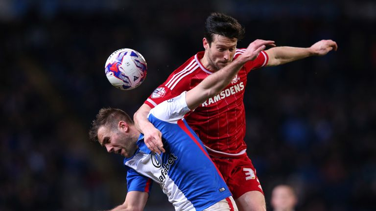 Tommy Spurr (left) of Blackburn Rovers and David Nugent of Middlesbrough compete for the ball