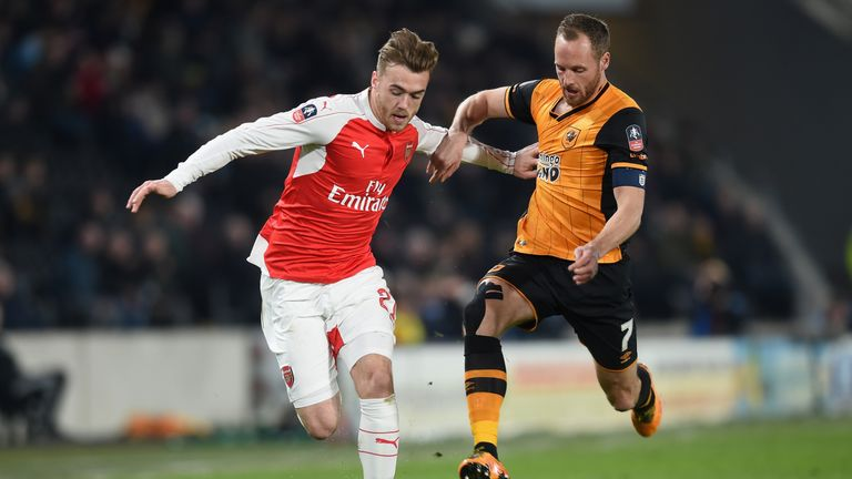 Calum Chambers of Arsenal is challenged by David Meyler of Hull City