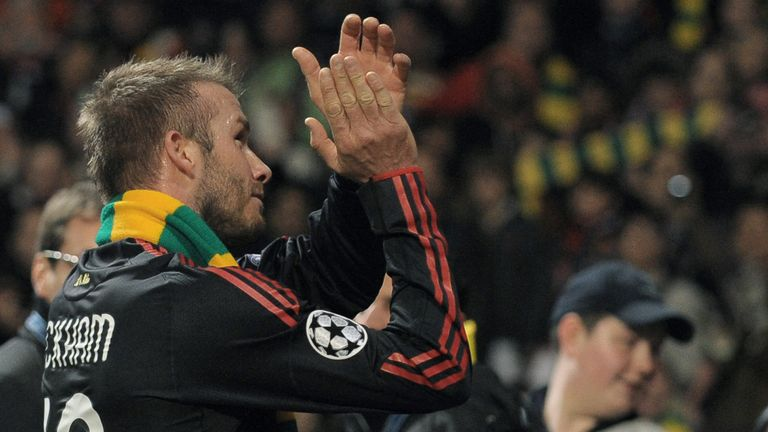 David Beckham wears a green and gold scarf after Champions League tie at Old Trafford