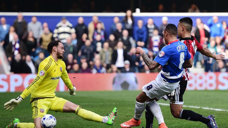 David Button of Brentford saves a shot from QPR's Tjaronn Chery