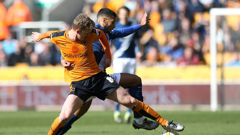 Birmingham's David Davis and Wolves' George Saville (left) battle