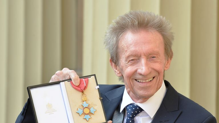 Denis Law poses with his Commander of the Order of the British Empire