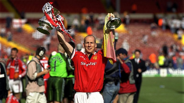 Stam lifts the FA Cup in 1999 on his way to a treble with Manchester United