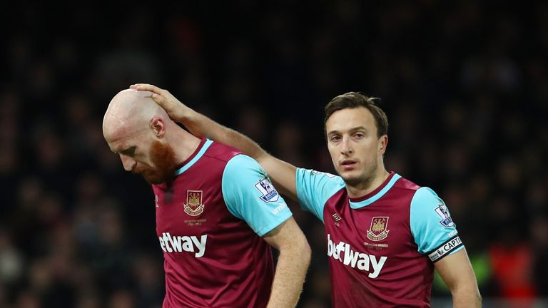 James Collins is consoled by Mark Noble as he goes off injured during West Ham's win over Tottenham