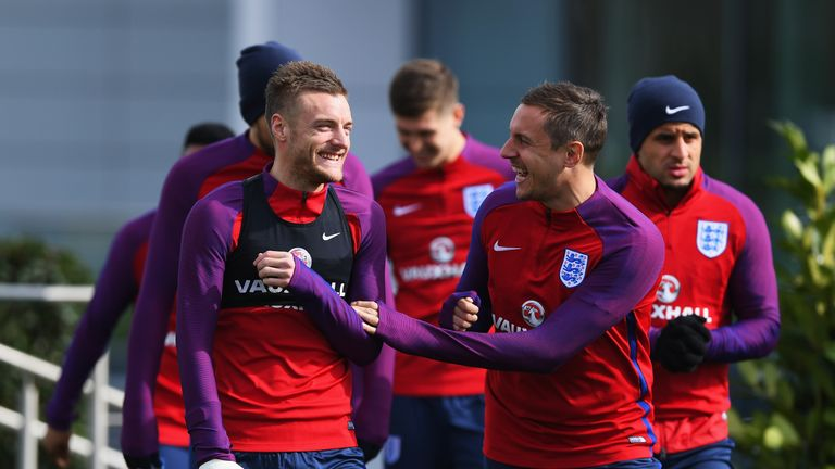 Jamie Vardy (l) and Phil Jagielka (r) are both expected to start for England against the Netherlands