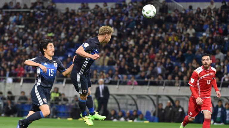 Keisuke Honda heads in a goal during his side's emphatic win.
