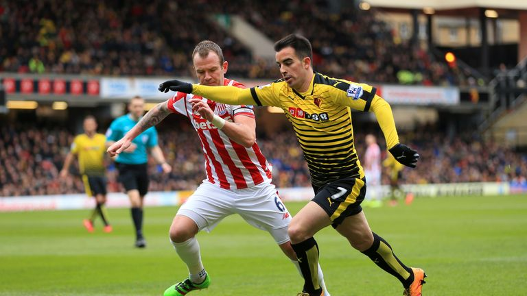 Jose Manuel Jurado gets away from Glenn Whelan