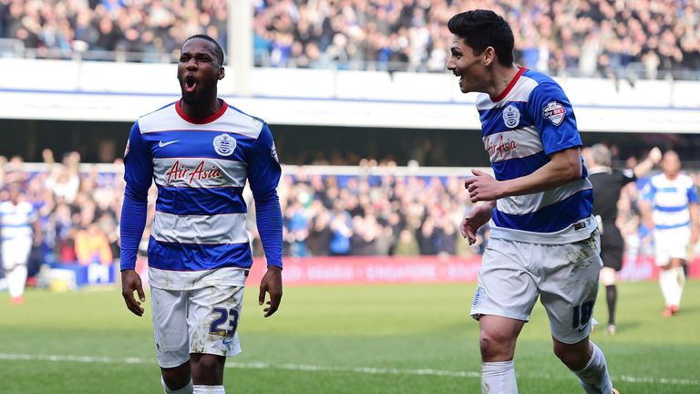 Junior Hoilett (L) of Queens Park Rangers celebrates scoring his team's opening goal
