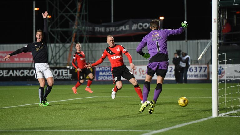 Rangers' Kenny Miller opens the scoring against Falkirk