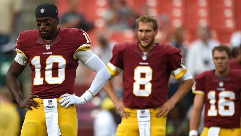Cousins (centre) beat Robert Griffin III (left) and Colt McCoy (right) to become Washington's starting quarterback