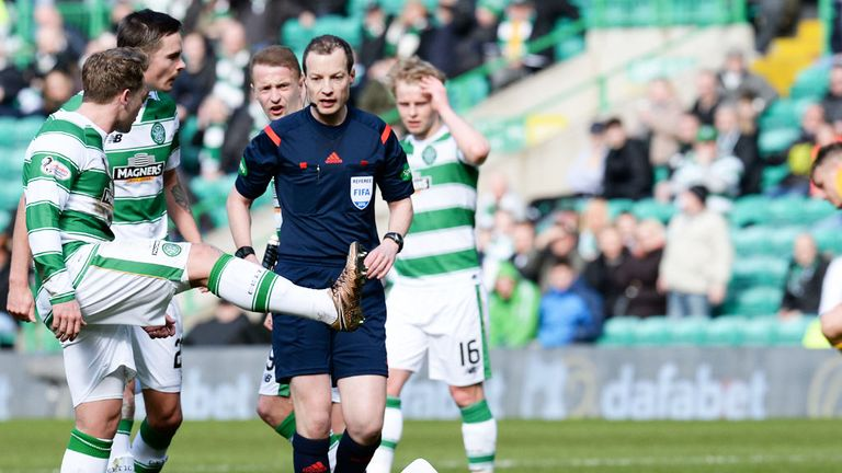 Kris Commons makes his feelings clear to referee Willie Collum after Stefan Johansen was injured
