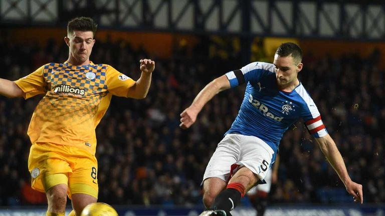 Lee Wallace of Rangers sweeps in the third goal of the night