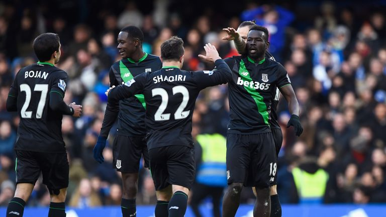 Mame Biram Diouf celebrates with his team-mates after equalising for Stoke