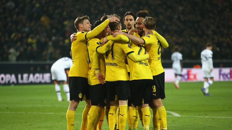 Reus is congratulated after scoring