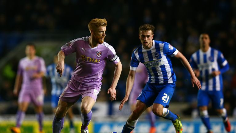 Paul McShane of Reading runs with the ball under pressure from James Wilson