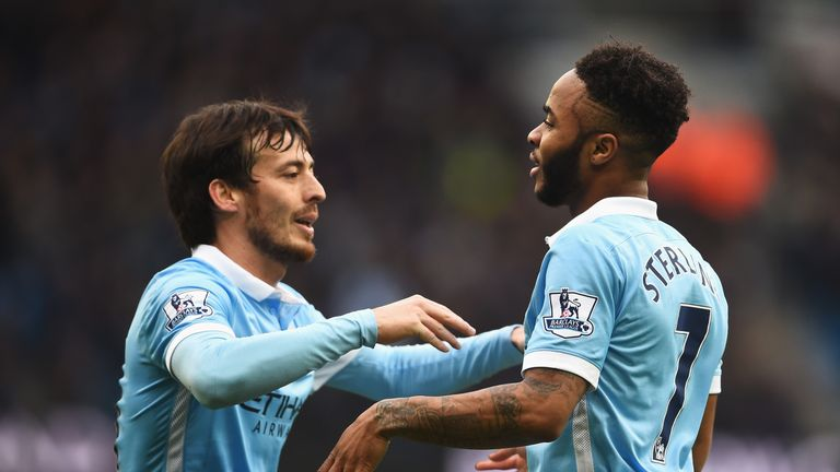 Raheem Sterling celebrates scoring his team's fourth goal with David Silva