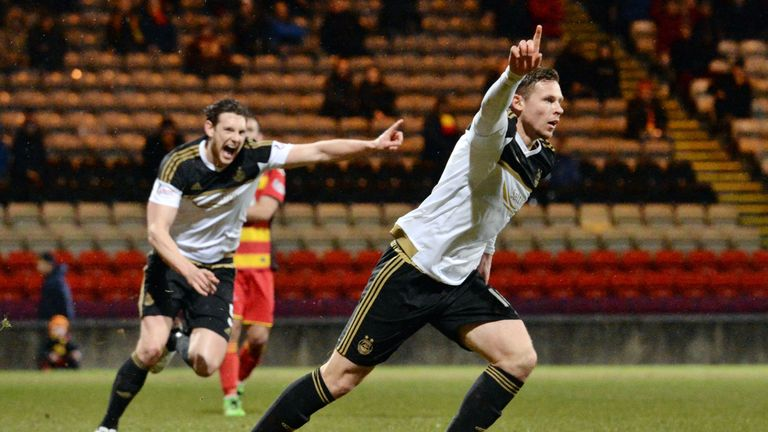 Aberdeen striker Simon Church (right) scores the winner at Partick