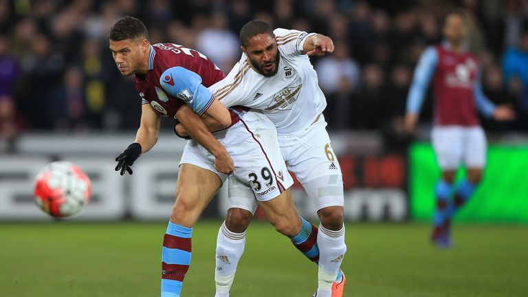 Rudy Gestede and man of the match Ashley Williams compete for the ball