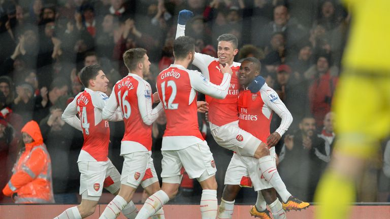 Joel Campbell is congratulated after scoring for Arsenal