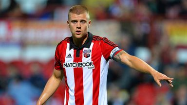 Brentford captain Jake Bidwell wants to leave the club this summer