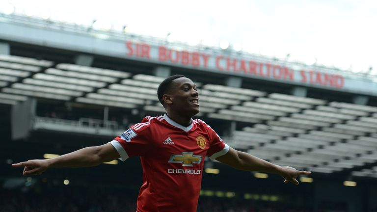 Manchester United's French striker Anthony Martial celebrates scoring the opening goal