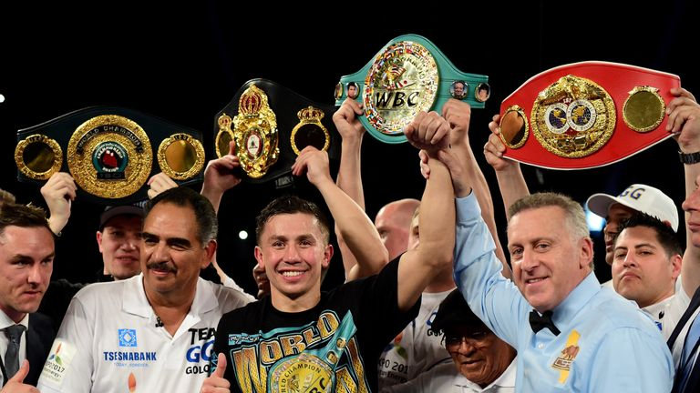 Golovkin poses with his belts after his second-round TKO of Dominic Wade in Los Angeles in April
