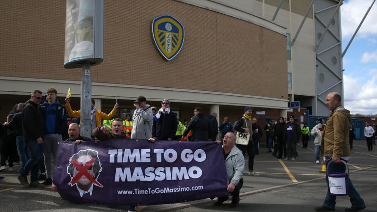 leeds fans march in protest against club owner massimo