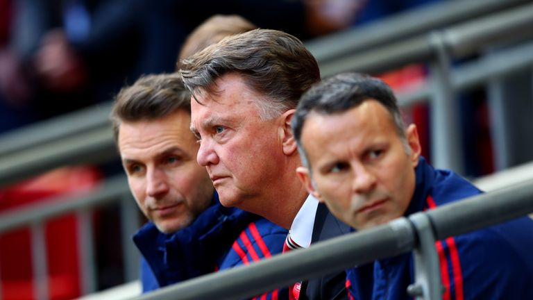 Giggs [right] was assistant manager at Man Utd under David Moyes and Louis van Gaal [centre]