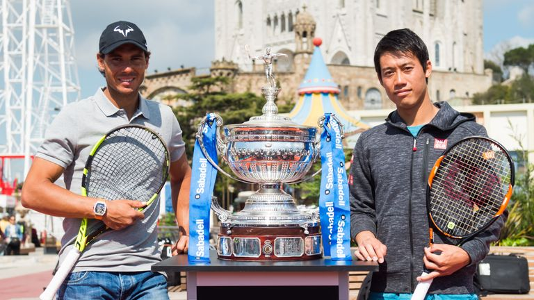 Rafael Nadal (left) and Kei Nishikori pose with the trophy