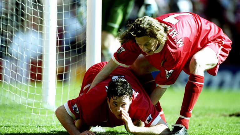 Robbie Fowler celebrates in his unique style alongside Steve McManaman
