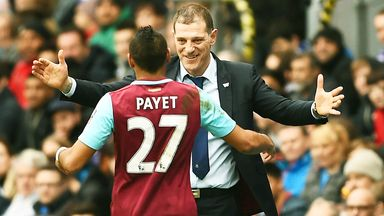 Dimitri Payet celebrates with West Ham boss Slaven Bilic