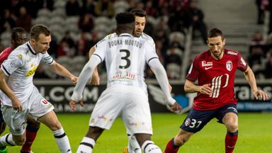 Lille's Morgan Amalfitano (R) keeps possession against Angers