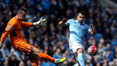 Shay Given is challenged by Sergio Aguero during Saturday's match against Manchester City