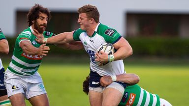 Connacht's Peter Robb fends off a challenge