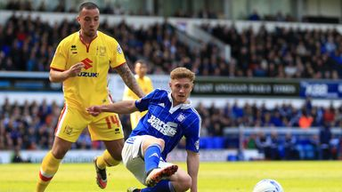 Teddy Bishop gets to the ball ahead of Samir Carruthers