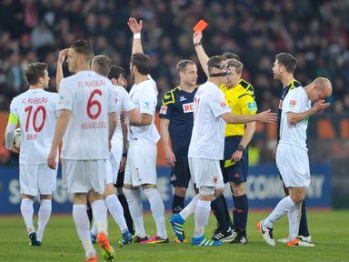 Matthias Lehmann of Cologne gets a red card