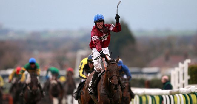 Jockey David Mullins celebrates as Rule The World wins the Crabbie's Grand National