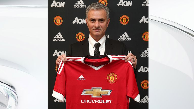 Mourinho poses with a United shirt after being confirmed as their new manager