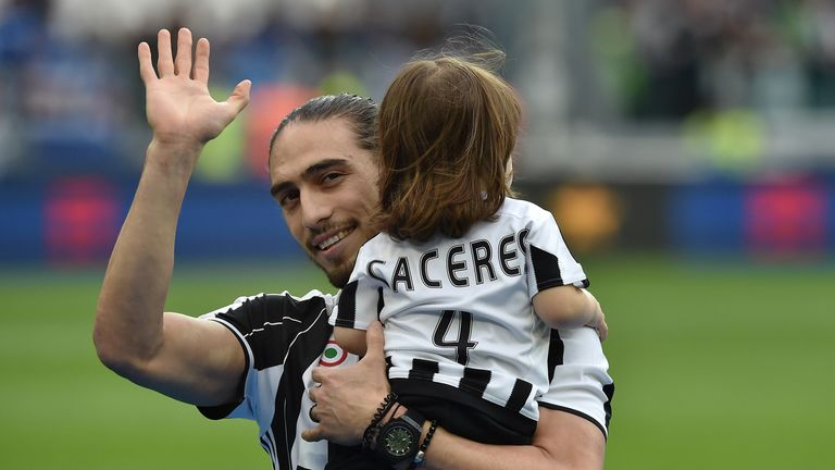 Martin Caceres waves to the Juventus fans