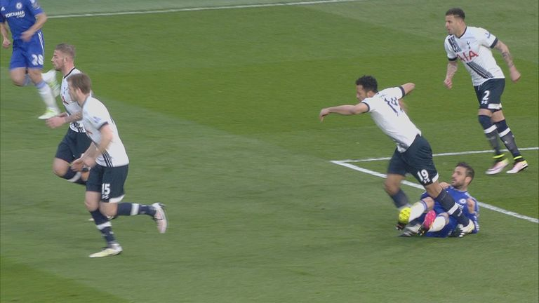 Cesc Fabregas appears to kick out at Mousa Dembele