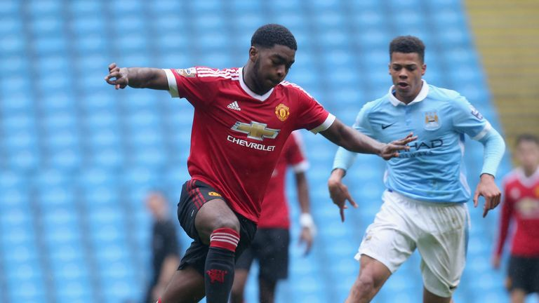 RoShaun Williams in action for Manchester United's U21 side against Ashley Smith-Brown of Manchester City