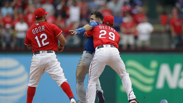 Jose Bautista (middle) was punched by Rougned Odor (left) to spark a brawl during Sunday's game