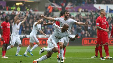 Andre Ayew scored twice to help Swansea to a 3-1 win against Liverpool.
