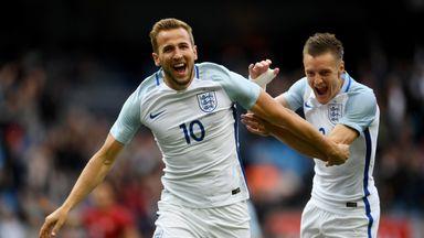 Harry Kane (L) celebrates with strike partner Jamie Vardy after scoring the opener against Turkey