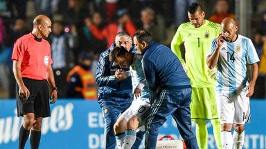 Lionel Messi is assisted after being injured during a the friendly win over Honduras
